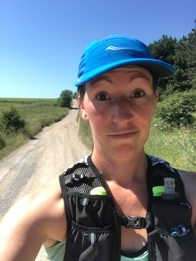 Myself on a long run during a heatwave - wearing suncream, cape and hydration pack.